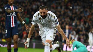 Benzema celebra uno de sus goles al PSG. (AFP)
