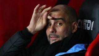 Pep Guardiola, en el banquillo durante un partido del Manchester City. (Getty)