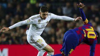 Valverde y Messi, durante un Clásico. (Getty)