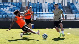 Miguel Gutiérrez y Marcelo durante un entrenamiento. (Realmadrid.com)