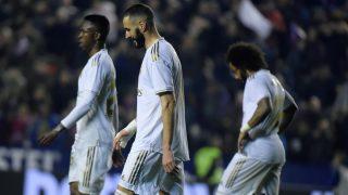 Benzema y Vinicius, cabizbajos en un partido. (AFP)