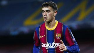 Pedri durante un partido con el Barcelona. (AFP)