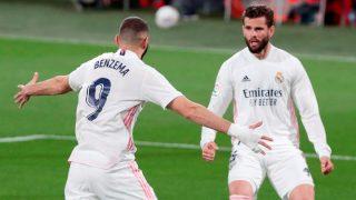 Benzema celebra uno de sus goles al Cádiz. (EFE)