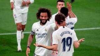 Marcelo celebra un gol con Odriozola. (EFE)