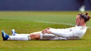Gareth Bale, en el suelo en un partido con el Real Madrid. (AFP)