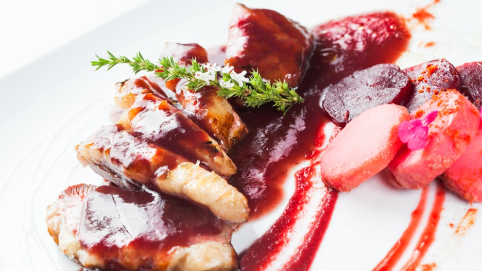 Duck magret meat with beet and cherry sauce, ready to eat.