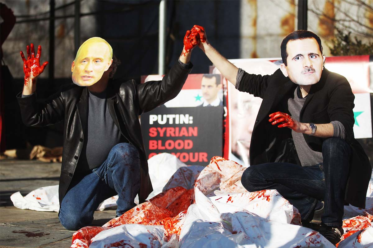 Activistas protestando en 2012 contra Putin y Al Assad (Foto: Getty)
