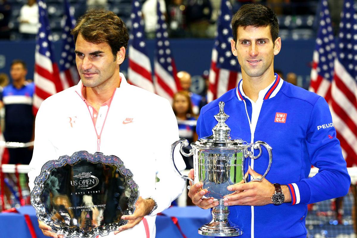 Djokovic y Federer posan con los trofeos tras la final del US Open el pasado fin de semana (Getty)