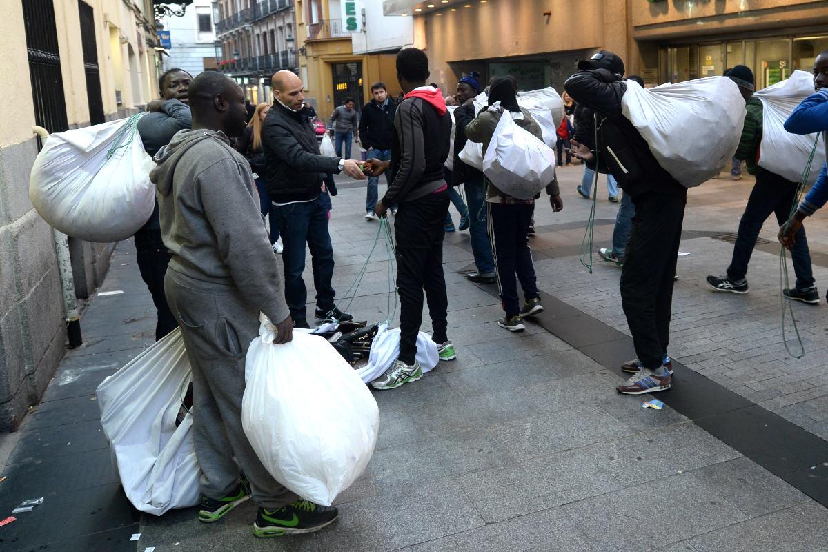 Inmigrantes en una calle de Madrid (Foto: Getty)
