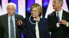 Clinton, entre Sanders y OMalley. (Foto: Getty)