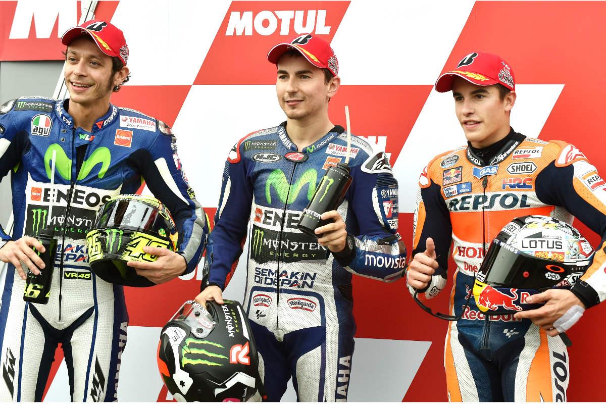 Valentino Rossi, Jorge Lorenzo y Marc Márquez, en el podio de Moto GP. (AFP)