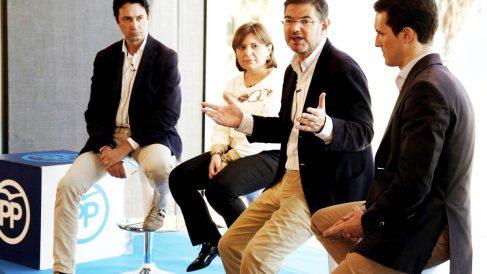 El ministro de Justicia, Rafael Catalá, junto a Pablo Casado y la presidenta del PP en Valencia, Isabel Bonig. (Foto: EFE)