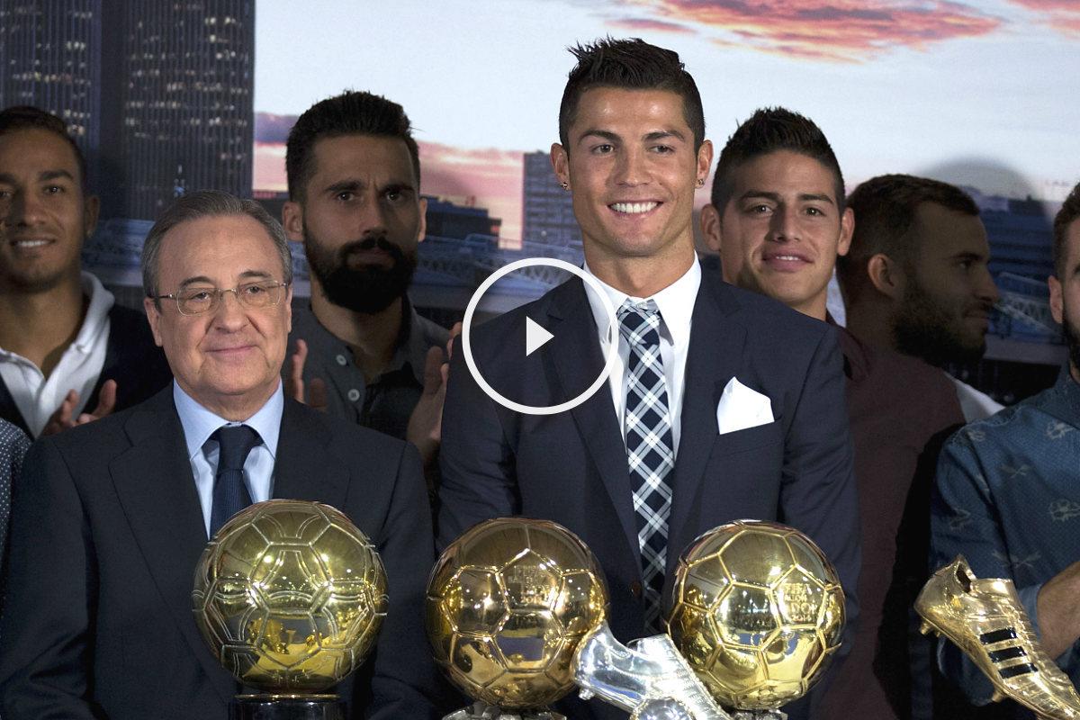Cristiano posa junto a Florentino Pérez y parte de la plantilla del Real Madrid.