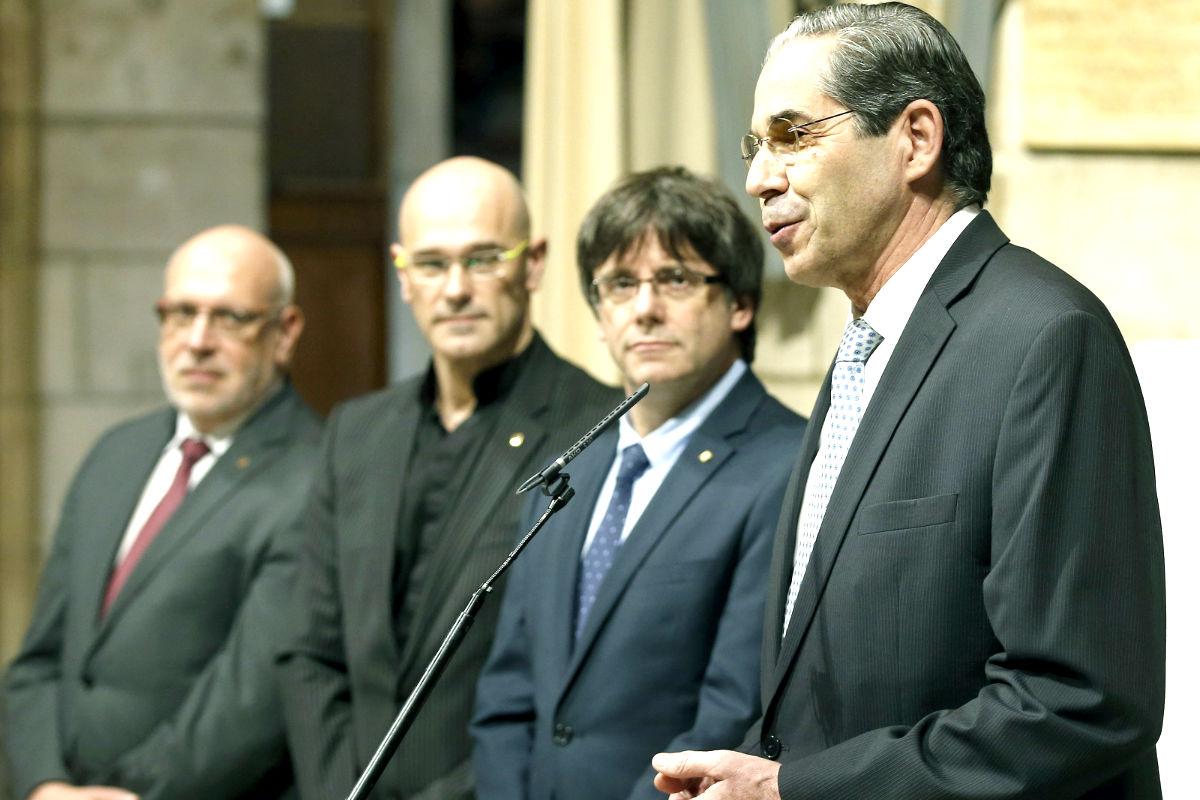 Puigdemont y Romeva en la reunión con los cónsules (Foto: Efe).