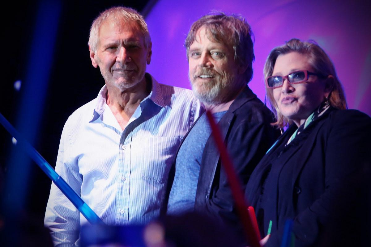 Harrison Ford, Mark Hamill y Carrie Fisher, en una presentación de Star Wars VII. (Foto: Getty)