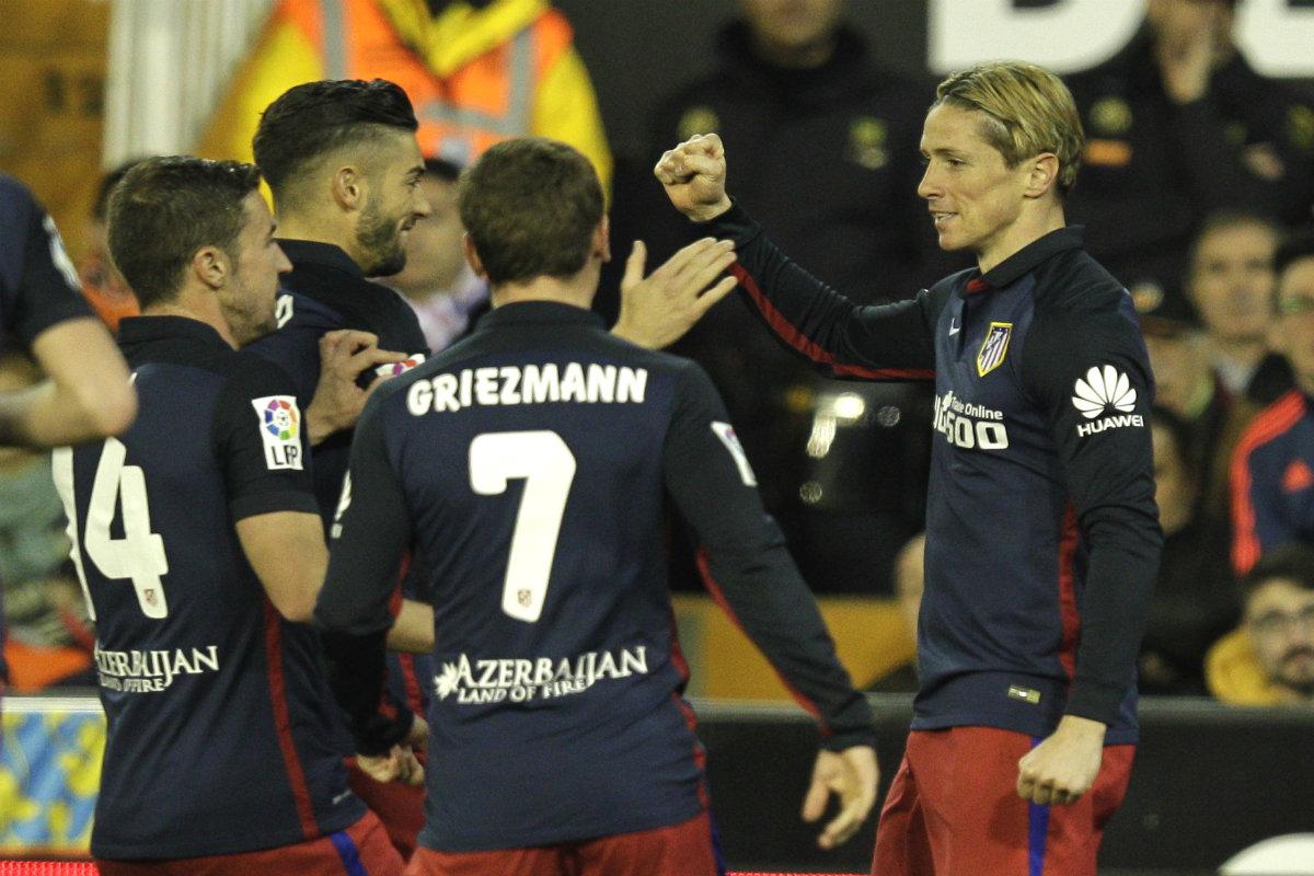 Griezmann, Gabi, Carrasco y Torres celebran el gol de El Niño. (AFP)