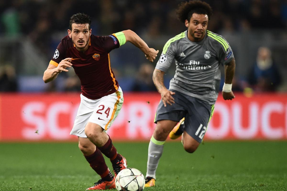 Florenzi, en una acción con Marcelo. (AFP)