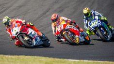 Iannone, con Márquez y Rossi. (Getty)