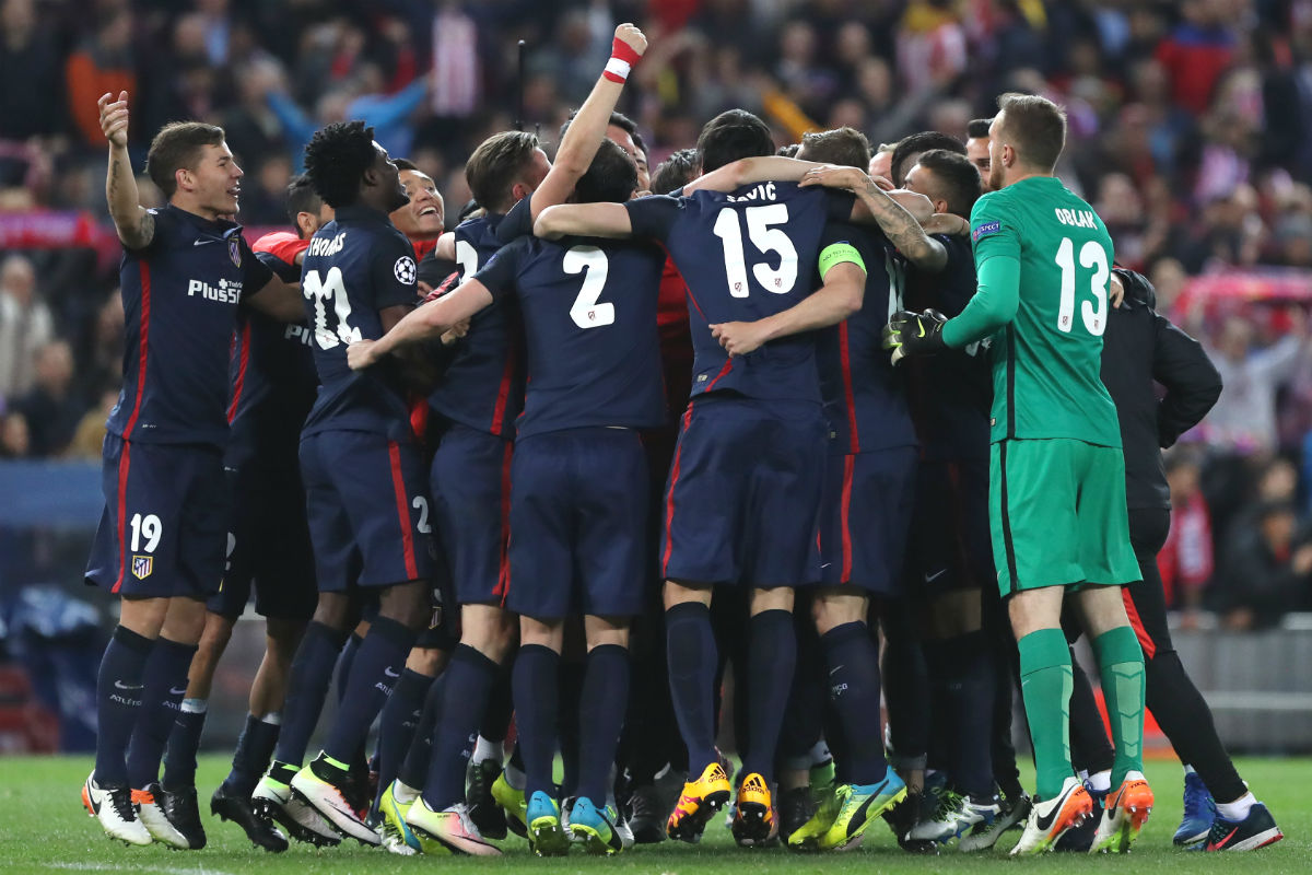 Los jugadores del Atlético celebran el pase a semifinales. (AFP)