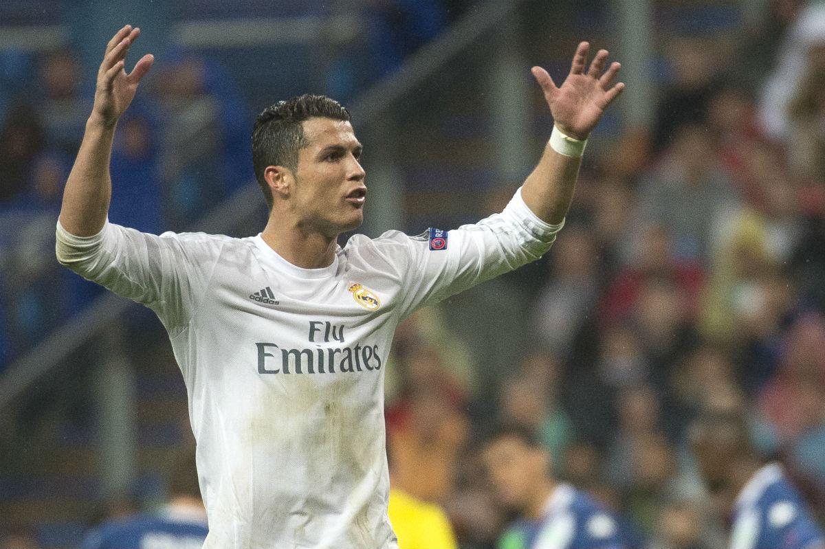 Cristiano Ronaldo celebra uno de sus tres goles al Wolfsburgo. (AFP)