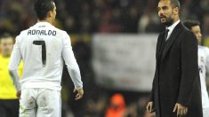 Cristiano y Guardiola, en un Clásico en el Camp Nou. (AFP)