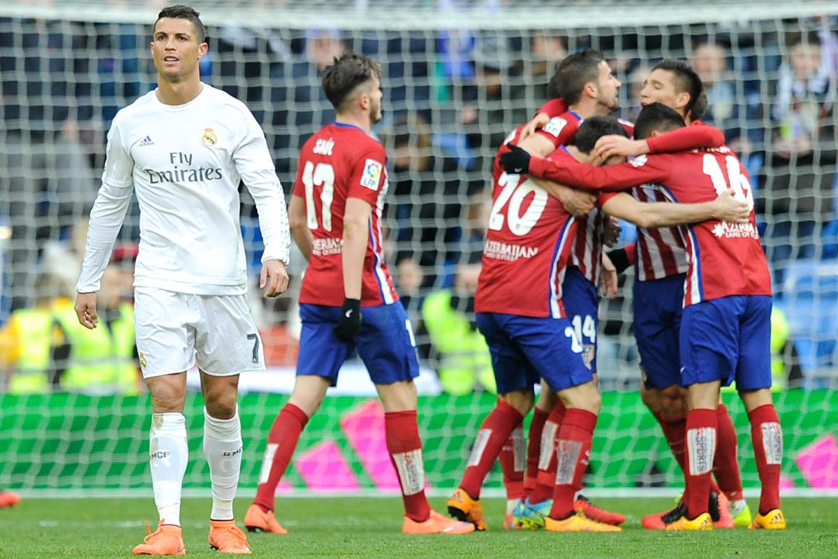 Los jugadores del Atlético celebran el gol en el Bernabéu. (Getty)