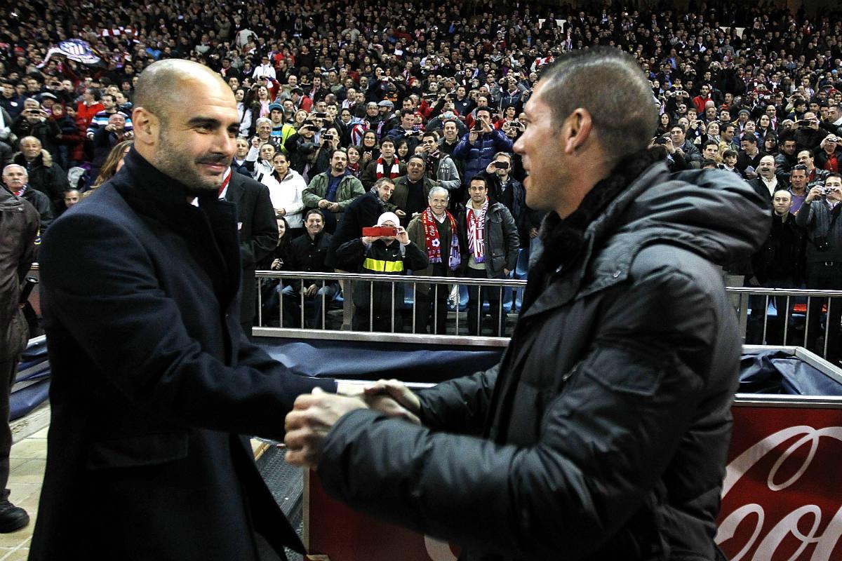 Guardiola y Simeone se saludan durante un Barça-Atlético. (Getty)