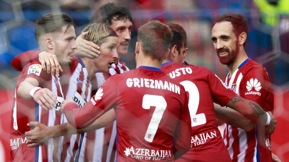 Los jugadores del Atlético celebran un gol de Torres. (Getty)