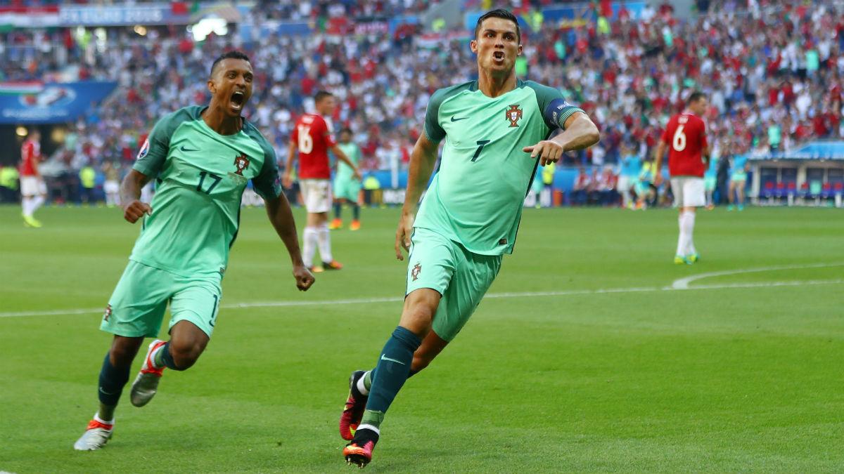 Cristiano Ronaldo celebra junto a Nani uno de los goles contra Hungría. (Getty)