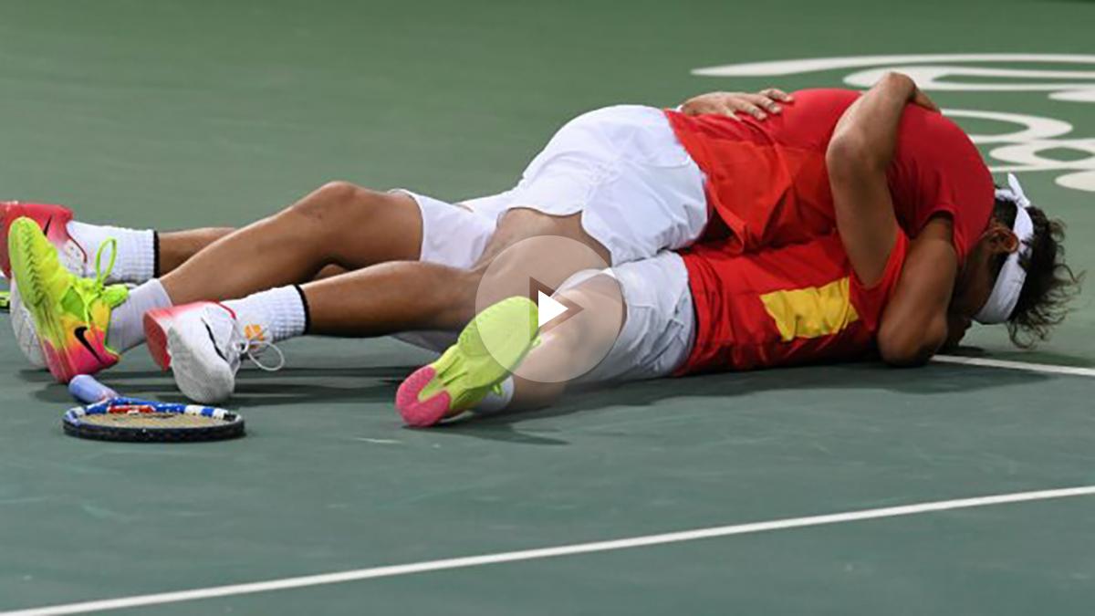 Rafa Nadal y Marc López. (AFP)
