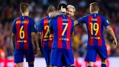 Arda Turan y Messi celebran uno de los goles