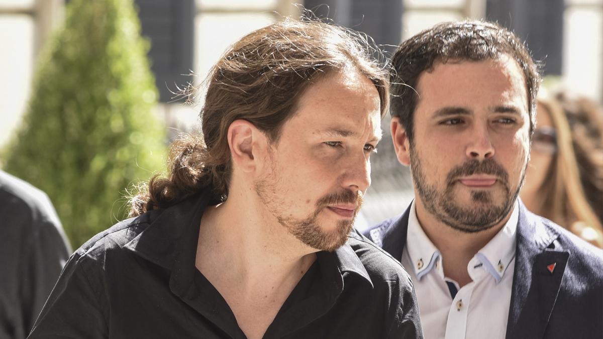 Pablo Iglesias y Alberto Garzón. (Foto: AFP)