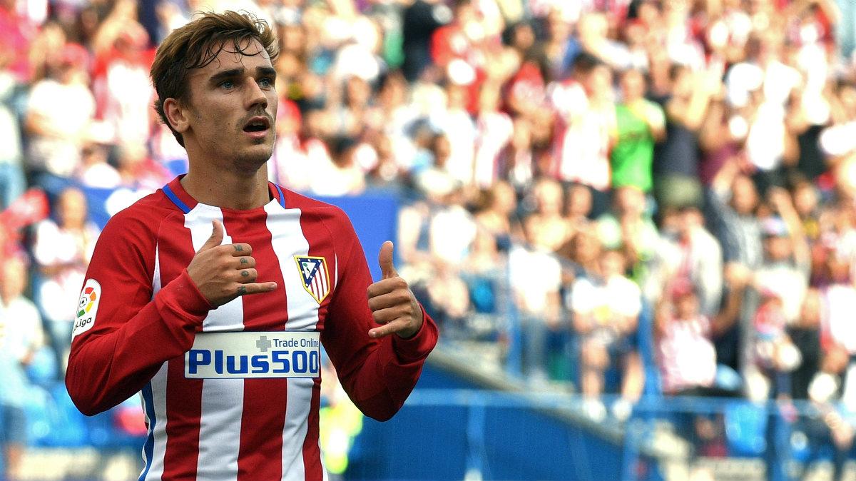 Griezmann celebra uno de sus dos goles en el Atlético-Sporting. (AFP)