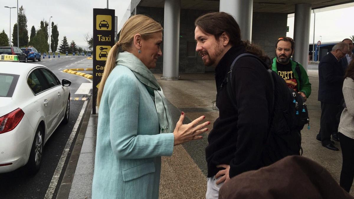 La presidenta de la Comunidad de Madrid, Cristina Cifuentes, con Pablo Iglesias, líder de Podemos. (Foto: TW)