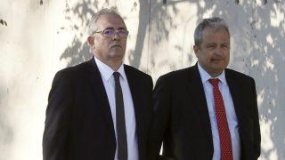 Francisco Verdú (izqda.), a su llegada a la sede del juicio de las tarjetas 'black'. (EFE)