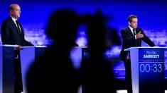 Alain Juppé y Nicolas Sarkozy al fondo, durante el debate de Los Republicanos. (AFP)