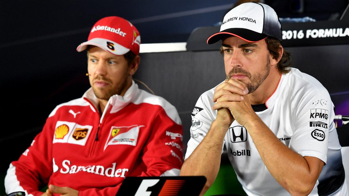 Alonso y Vettel tienen una relación muy tirante. (AFP)