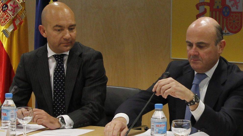 Jaime García Legaz y Luis de Guindos. (Foto: EFE)