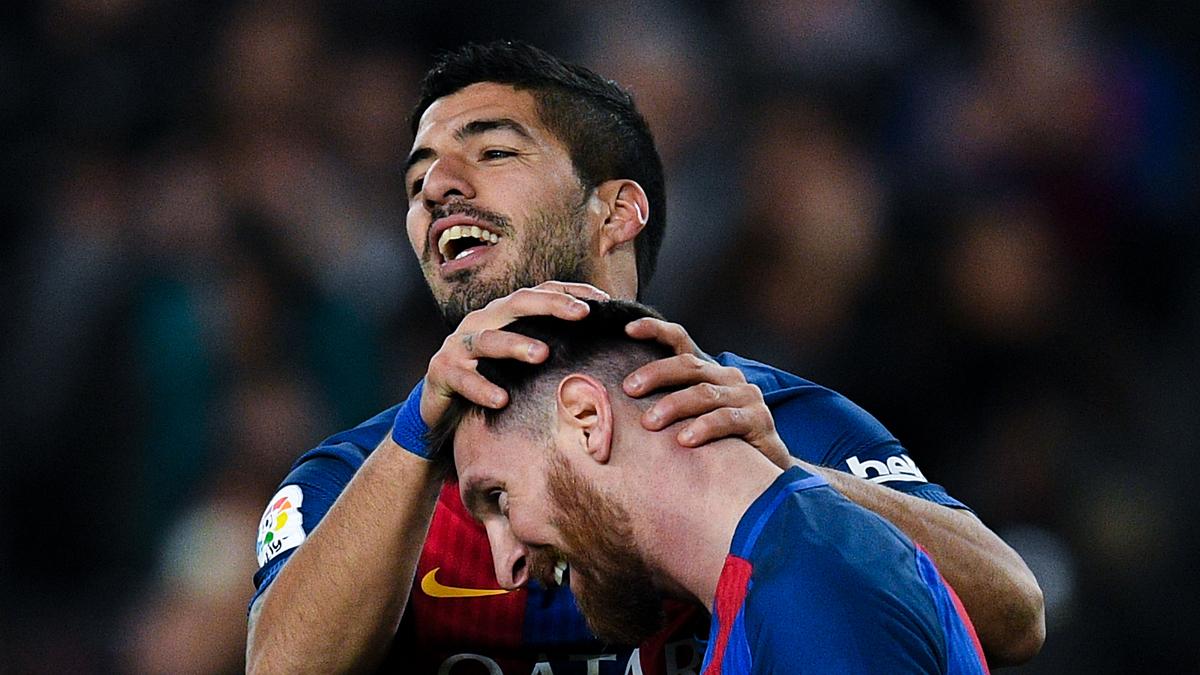 Luis Suárez y Messi, celebrando uno de los goles ante el Espanyol.