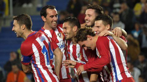 Varios jugadores del Atlético, celebrando el gol de Griezmann.