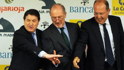 José Luis Olivas junto a Rodrigo Rato. (Foto: AFP)