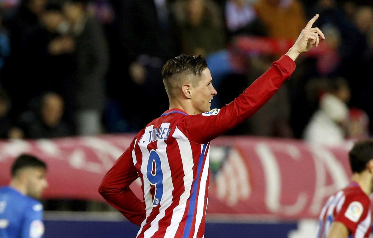 Fernando Torres celebra uno de sus goles ante el Leganés