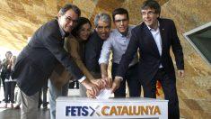 Carles Puigdemont, junto a Artur Mas y Francesc Homs en un acto celebrado el pasado mes de junio Foto: EFE).