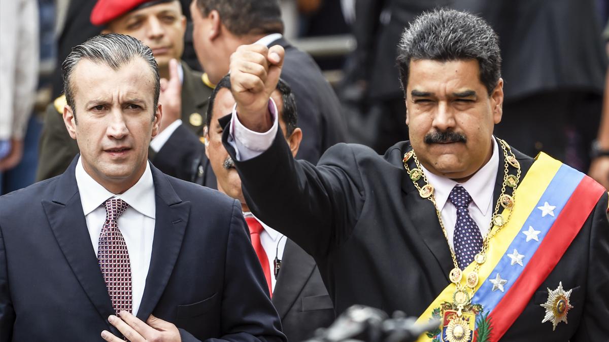 Tareck El Aissami y Nicolás Maduro (Foto: AFP).