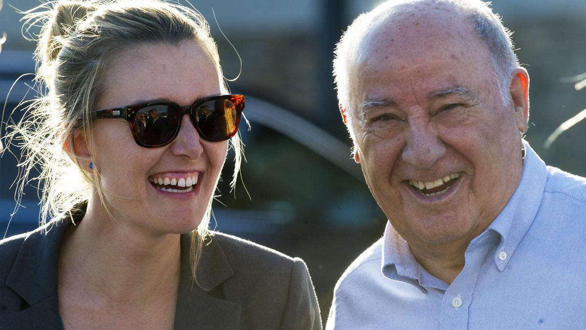 Amancio Ortega con su hija Marta. (Foto: AFP)
