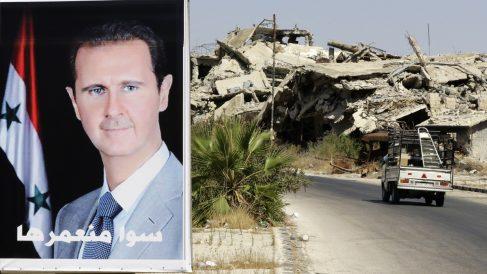 Un cartel de Bashar Al Assad en Homs. (Foto: AFP)