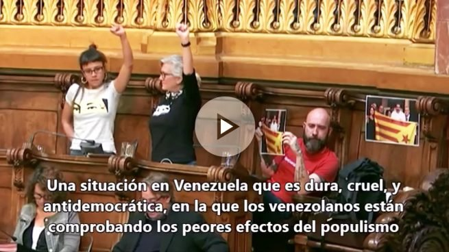 La CUP exhibe con orgullo la foto del asesino Maduro con la estelada mientras el PP exige la condena