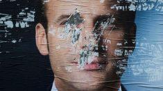 Un cartel borrado de Emmanuel Macron, candidato a la Presidencia de Francia. Foto: AFP