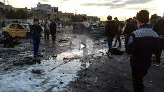 Personas en el lugar del atentado en Bagdad (Foto: AFP).