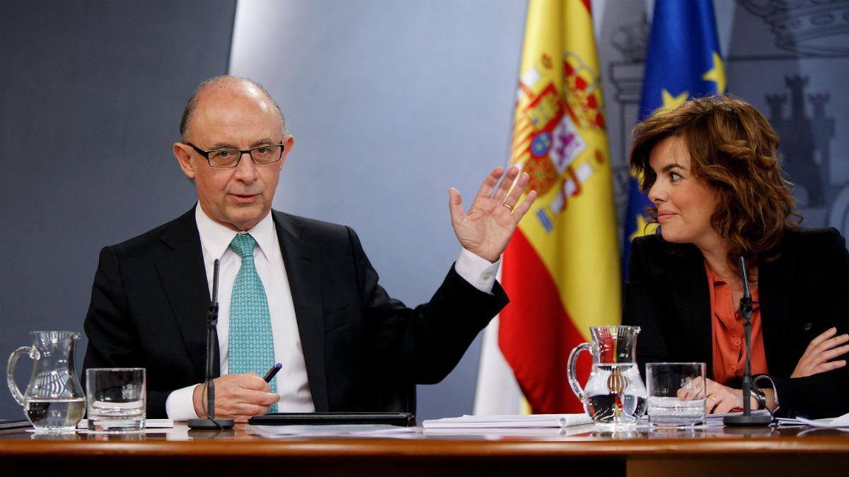 Cristóbal Montoro y Soraya Sáenz de Santamaría (Foto: GETTY).